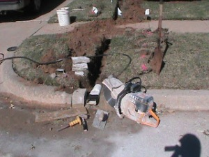 Cutting the curb for outlet for a French Drain